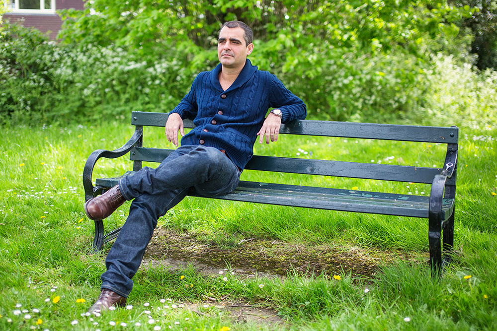 05_man-on-bench-green-portrait